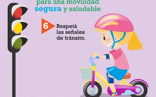 Señal de alto, niña en bicicleta haciendo señal de alto